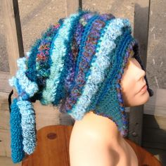 Freeform Crochet Hats with earflaps  by woolmountain, pattern via Ravelry