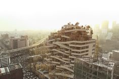 "The Tehran-based architectural design studio Farshad Mehdizadeh has designed ""Tehran Eye, Vertical Street"" a façade design and reorganization of an existing structure that located in Tehran, Iran. Architecture Concept Diagram, Architecture Panel, Architecture Magazines, Contemporary Architecture, Amazing Architecture, Architecture Design, Green Architecture, Architectural Design Studio, Commercial Complex"