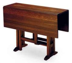 AN AMERICAN ARTS AND CRAFTS OAK GATELEG  TABLE,  Lots of Foot room due to raised cross brace under the table