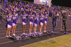 The Moffat County High School cheerleaders with coach Britany Nielson and the MCHS Bulldog mascot raise the energy of the varsity football team during a crucial game moment. From left: Katie Haskins, Marlayna Sparger, Jazzmine Piatt, Jodi Fortune, Katie Bohne, Cassidy Griffin and Laura Bolton.
