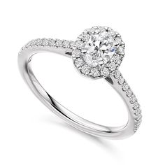 Platinum 0.62ct oval diamond with halo surround engagement ring | Diamonds | New Arrivals | Fraser Hart Jewellers | http://www.fraserhart.co.uk/platinum-0-62ct-oval-diamond-with-halo-surround-engagement-ring.html