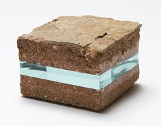 Born in Tokyo, Dusseldorf-based artist Ramon Todo creates beautiful textural juxtapositions using layers of glass in unexpected places. Starting with various stones, volcanic rock, fragments of the Berlin wall, and even books, the artist inserts perfectly cut glass fragments that seem to slice throu