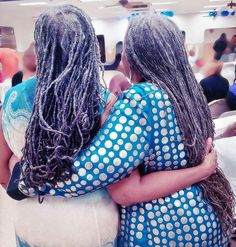My aunt and mother. Beautiful long silver dreadlocks. Gray locs