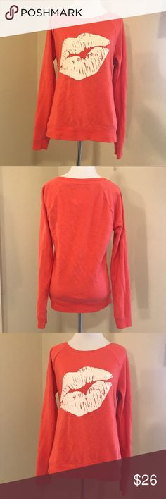 """Victoria's Secret Sweatshirt Small Lips Pullover Super cute Victoria's SecretAngel's Orange Kiss Lips Sweatshirt in GREAT condition. Only worn afew times.(Small paint pen splattered but hardly noticeable. see pics)  Size Small Petite -60% Cotton - 40% Polyester - SOFT AND COMFY MATERIAL -Long Sleeves - Crew Neck Style *SHIPS FIRST CLASS MAIL USPS*  Flat Lay approx. Measurements: -Underarm to Underarm flat - 20"""" -Shoulder seam to hem - 26"""" -Sleeve length - 25"""" Victoria's Secret Sweaters…"""