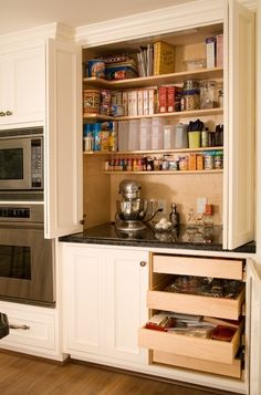 Kitchen - A baking centre with equipment, supplies, utensils, etc....handy/organized all in one place.