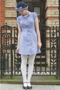 gingham, tucks, baby doll sleeves, mini, white tights, mary janes with little heels (can't see in the pin)