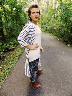 LuLaRoe leggings and an Irma tunic top are dressed up with a long cardigan. Pattern mixing is fun! Join our Facebook group for creative ways to style outfits and opportunities to purchase styles like this one. https://www.facebook.com/groups/LuLaRoeLiliesShoppe