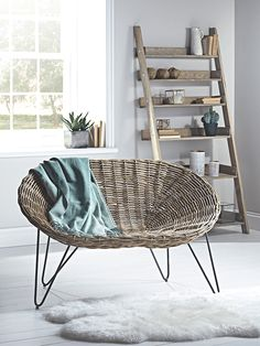 Inspired by our bestselling Rattan Cone Chair, our large cone chair has been woven from natural rattan with a strong elegant frame. A nod to the 1950's, this love seat style chair is the perfect size for two cosy people, or as a spacious seat for one. Complete the look by teaming with our sumptuous Sheepskin Collection or luxurious Velvet & Linen Cushions. Due to the size and weight of this item it is not currently available for international delivery. In exceptional circumstances please…