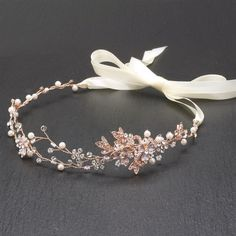 """Hand-painted metallic leaves, Swarovski crystal flowers and freshwater pearls are entwined with wire creating a breathtaking rose gold bridal headpiece. The flexible vine tiara headband has 14"""" of del"""