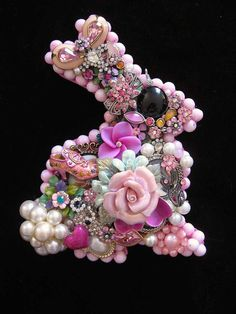 This adorable pink pearled bunny is hand layered with vintage earrings, brooches, rhinestones, enamel, crystals, pearls and flowers. This one of