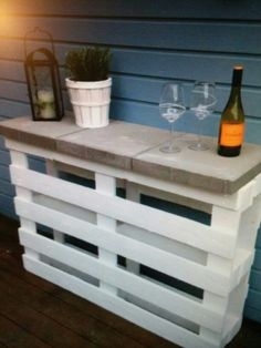 2 pallets, 3 pavers and white paint