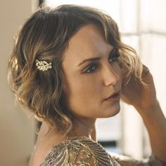 """Brides.com: . Hollywood's perfect formula for a red carpet-ready beauty look? A smoky eye, dreamy waves, and a sparkly, vintage-looking hair clip. And it turns out, this translates perfectly for your bridal style, too. """"On damp hair, run a flexible hold mousse from roots to ends all over your hair and comb through. Blowdry hair and use a 3/4"""" curling iron and curl in one-inch sections,"""" says Lauren Hack of Lauren+Vanessa. """"Spray each section with hairspray before you curl—that will help…"""