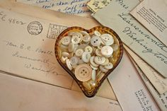 heart dish with white buttons