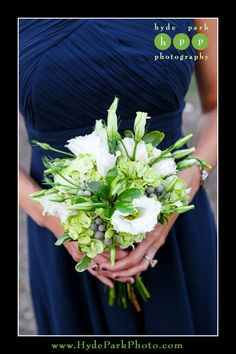 The bridesmaids wore navy blue dresses and carried lime green bouquets with white flowers.