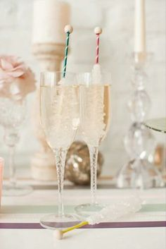 champagne with rock candy swizzle sticks