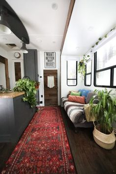A Couple Transform a Toy Hauler Into a Mobile Tiny Home For $6K - Photo 7 of 10 - The kitchen now houses a dark, granite composite sink with a black faucet.