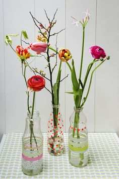 Juice bottle, Flowers and Tape by Studio Sjoesjoe