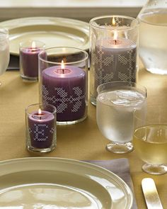 Use a paint-pen to decorate candles with monograms or other designs