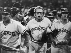 10-Cent Beer Night 38 years later: Texas Rangers' Jeff Burroughs, center, runs off the field with his teammates during the Beer Night melee at Cleveland Stadium June 4, 1974. The Indians forfeited the game to the Rangers after fans, fueled by 10-cent beers, stormed the field in the ninth inning.