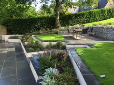 Landart coupled our Midnight Black Limestone with Blue Grey Granite to create this modern garden design, creating a terraced effect across the multiple levels.