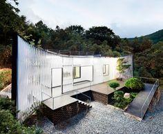 JOHO Architecture's Lattice-Wrapped Namhae House Harmonizes With Nature