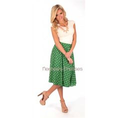 """Gorgeous full mid length skirt, with side zipper closure and front pockets, in an adorable green and white polka dot print. From the Mikarose Spring 2014 Collection.Extended InformationMikarose Size Chart for Woven FabricSizesXS       0 to 2 S       4 to 6M       8 to 10L       12 to 14XL       16 to 182XL       20 Bust Inches32"""" to 34""""35"""" to 36""""36"""" to 38""""38"""" to 40""""40"""" to 42""""42"""" to 44""""Natural Waist27"""" to 29""""29"""" to 30.5""""30.5"""" to 32""""32"""" to 33.5""""33.5 to 35""""35"""" to 36""""Hips39"""" to 41""""41"""" to 42""""42""""…"""