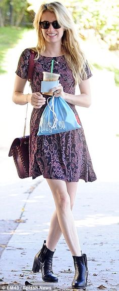 Emma Roberts. Im a sucker for a dress with boots and this girl rocks the look