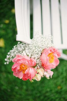 baby's breath with coral peonies