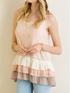 Girly tank top in pink with nude colored ruffles. Throw it on with a pair of jeans and call it a day, while looking cute!