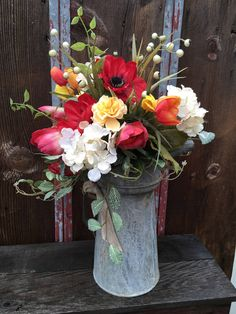 Antique Automotive Can With Red Tulips, Cream Hydrangea, Dark Red Poppies, and a mixture of yellow flowers, Farmhouse Floral Arrangement, by SheilasHomeCreations on Etsy