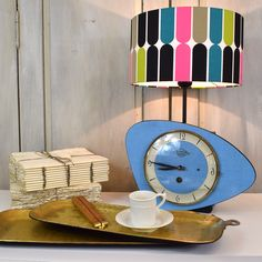 Retro lamp creation from Kiki L'eclaireur. Combines rare French wind-up clock - in perfect working order - with complementary boldly bright vintage light shade. Retro Table Lamps, Vintage Lamps, Vintage Lighting, Unique Vintage, Vintage Clocks, Vintage Watches Uk, Ships Clock, Retro Lampe, Light Shades