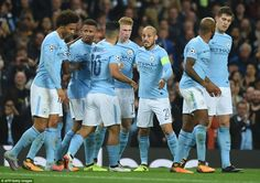 The Manchester City players celebrate De Bruyne's opener after having to be patient during a goalless first-half at the Etihad
