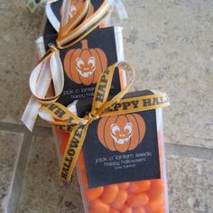 Orange tic-tacs, and a sticker that says pumpkin seeds. Give out to trick-or-treaters or for a halloween gift.
