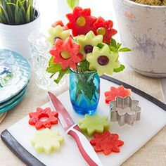 Serve your mama something she deserves—flowers! These adorable edible melon flowers are so easy to make, they take just a few minutes. You'll need a pack of skewers, a flower cookie cutter, and a metal icing tip to cut and form each flower. Served in a little vase or glass cup, these sweet skewers are a sweet treat your mom will love to eat!