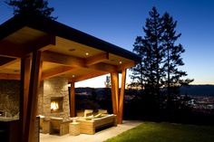 Timber frame summer kitchen looking down the city. Design by Willms Design Services.