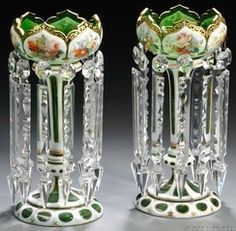 lighting, Czechoslovakia, A pair of Bohemian overlay glass girandoles [or lustres]  each white cut to green and with gilt trim and polychrome enameled flowers, cut prism pendants. CIrca 1801-1900
