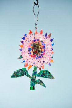 Enchant your space by hanging this beautiful ornament in your garden, porch or a window where it can catch the light.  Double Sided.  100% Handmade.