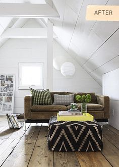A mini living room in the attic. Love the use of an ottoman instead of a coffee table that eats up floor space! | designsponge.com