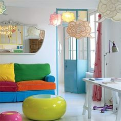 love the white with pops of bold colors! i could see this as an office space or kid's den.
