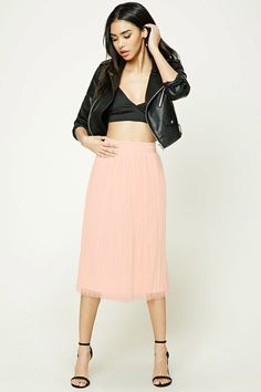 A midi skirt featuring a sheer tulle overlay with a pleated design, a knit underlayer, and a elasticized waistband.