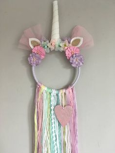 A handmade unicorn Dreamcatcher made using a 6inch hoop and tassels measuring around 30cm long. If you would like to pick your own colours just pop a note on your order with any requests.
