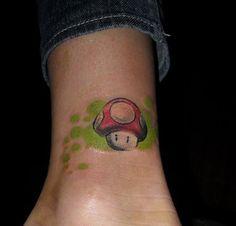 15 Groovy Mushroom Tattoos - Tattoo Me Now I Tattoo, Cool Tattoos, Mario Tattoo, Psychedelic Tattoos, Video Game Tattoos, Mushroom Tattoos, Gaming Tattoo, Circle Of Life, Tattoo Designs
