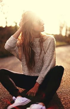 Ami tore this photograph to their profile. More than 38 StyleSaints retore this image. Glitter sweater, black leggings, tennis shoes, sun, sepia, glare, street style.
