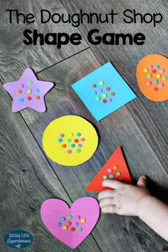 Playing games and singing songs is always a fun way for young children to learn. One of my favorite preschool activities is to play The Doughnut Shop Shape Game for Kids. It is an entertaining and educational learning shapes game for young children. Indoor Activities For Kids, Kids Learning Activities, Preschool Activities, Crafts For Kids, Shape Activities, Group Activities, Toddler Learning, Preschool Worksheets, Teaching Ideas