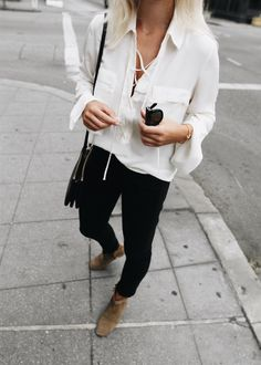White lace-up shirt, Isabel Marant boots, Céline sunglasses & Céline trio bag. Via Mija