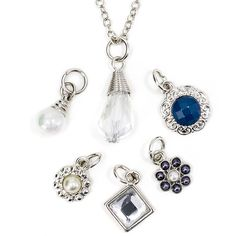 """#celebratemonday with this lightweight 18"""" silver toned necklace complete with six elegant charms. You decide! Do you want to include a pearl, stone, beads, or all? Choose from the following: pearl, three flowers with beading, faux princess cut diamond or the clear teardrop faceted bead. Whichever you choose, you will look astounding. #laurajanelle #ivystone #enCHARMing #necklace #charm #charms #charmnecklace #flower #elegant #trending #ontrend #beads #stone #pearl"""