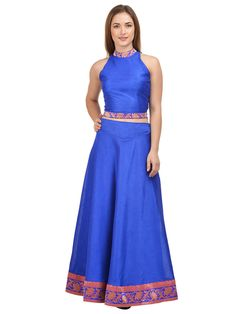 Add pizzazz to your look as you wear this Royal Blue Lehenga With Royal Blue Crop top from the house of Castle. Made from Raw Silk, these Skit with Top will accentuate your look effortlessly. Club these with Orange top and step out in a casual yet classy look.