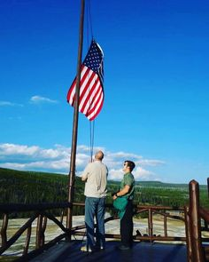 Craig lowering the #flag on the #oldfaithfulinn roof. What an honor. #YouAreTheParks #the59parks #travel #yellowstone #yellowstonenationalpark #nps #nationalpark #findyourpark