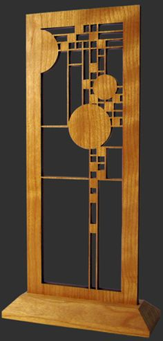 Create a unique look with this elegant wood accent piece. Each screen has been precision laser-cut and comes with a cherry veneer finish. This design is an adaptation from the upper section of one of the many art glass windows in the Coonley Playhouse, designed by Frank Lloyd Wright for Avery and Queene Coonley in 1912. This colorful tall narrow window was located at the rear of the building, which is located in Riverside, Illinois.  Made in the USA.