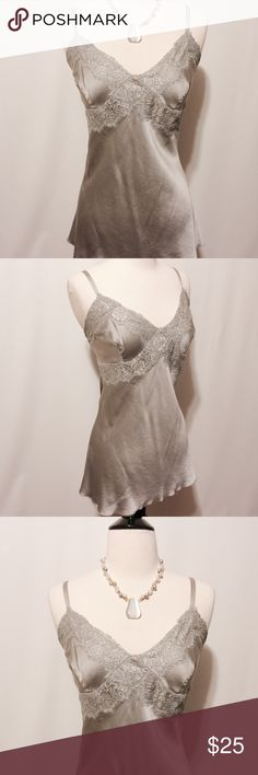 "✨ EXPRESS Silver Grey Silk Camisole Fabulous camisole! Silk and spandex bias cut for awesome fit. Lace accents on neckline and bust. Adjustable lingerie straps with goldtone hardware. 93% silk 7% spandex Dry Clean 40"" bust 28"" overall length Express Tops Camisoles"